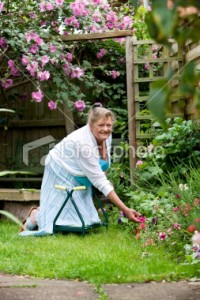 Woman kneeling in garden