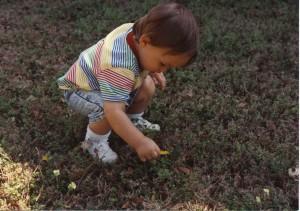 curious boy in grass by KC OK